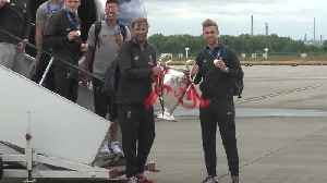 Champion League winners Liverpool arrive home [Video]