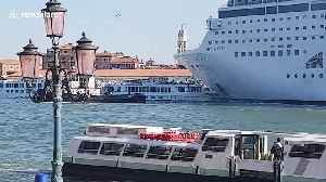 Moment cruise ship rams into tourist boat at Venice harbour [Video]
