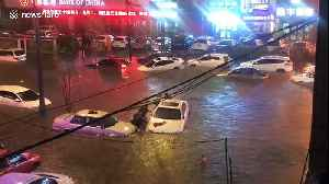 Vehicles submerged in deep water after heavy rainstorm causes floods in China [Video]
