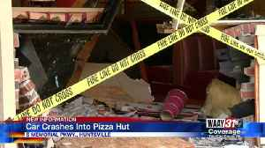 Car Crashes Into Pizza Hut [Video]