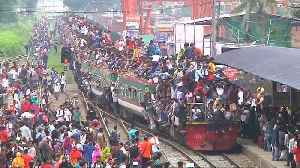 Watch: Bangladeshis crowd trains and ferries hoping to make it home for Eid [Video]
