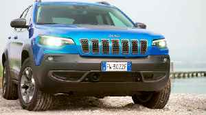 Jeep Cherokee in Blue On Road Driving [Video]