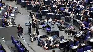 Watch: Youth climate change demonstrators protest in German parliament [Video]