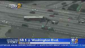 Big Rig Hits Center Divider, Blocking 3 Lanes On SB 5 Freeway In Commerce [Video]