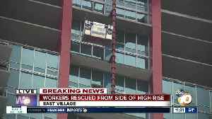 Fire crews save workers from side of downtown high-rise [Video]