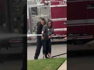 Firefighter's Family Uses Hose to Reveal Baby's Gender [Video]