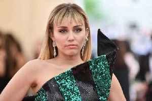 News video: Miley Cyrus Assaulted by Fan During Trip to Spain