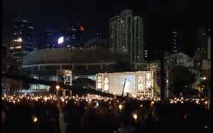 Demonstrators Raise Candles and 'Torch of Democracy' at Tiananmen Square Vigil [Video]