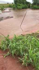 Massive Flooding Washes Road Away [Video]