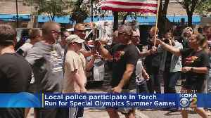 Local Law Enforcement Participate In Torch Run For Special Olympics [Video]