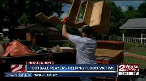 Charles Page High School's football team helps flood victims [Video]