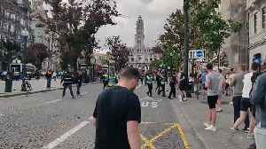 England football fans clash with police in Portugal [Video]