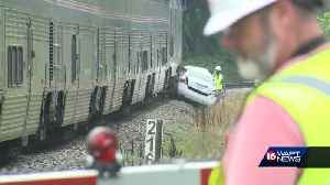 Teen driver injured when car, Amtrak train collide [Video]