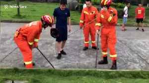 News video: Firefighters break drain cover to get ID card back for student in China