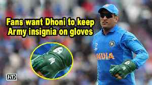 News video: Fans want Dhoni to keep Army insignia on gloves