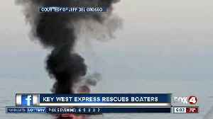 Boaters rescued from fire by Key West Express [Video]