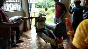 Snake-catcher pulls deadly king cobra from motor scooter [Video]