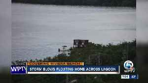 Storm blows floating home across lagoon [Video]