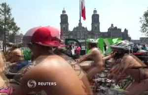 Nude bike ride turns heads in Mexico City [Video]