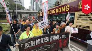 Hong Kong protesters march against China extradition bill [Video]