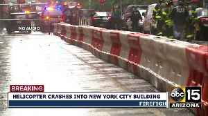 Helicopter crash lands on top of New York city building [Video]