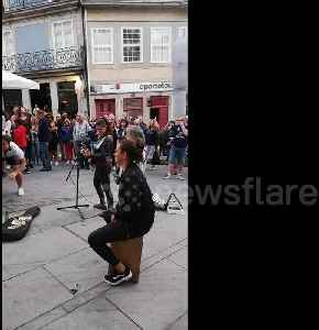England fans sing with busker in Porto and receive guard of honour from locals [Video]