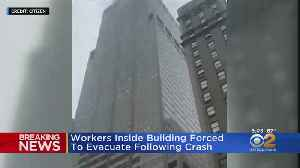 Workers Inside Manhattan Building Forced To Evacuate Following Helicopter Crash [Video]