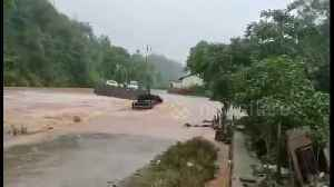 Flash floods sweep away car after driver tried to force their way through submerged road in China [Video]