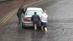 Kind men help stranded motorist during flooding in West London [Video]