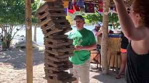 Girl Pulls off Crazy Move in Jenga Game [Video]