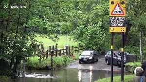 UK drivers cross flooded road in Birmingham despite warnings [Video]