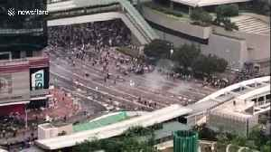 News video: Hong Kong police fire tear gas into crowd of protesters