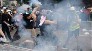 News video: Hong Kong Police Fire Pepper Spray At Protesters