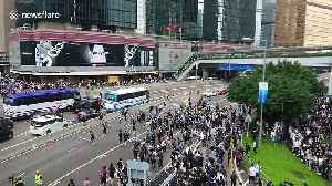 Protesters block Harcourt road in central Hong Kong [Video]