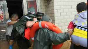Woman trapped in flooded house cries out after firefighters finally arrive to rescue her [Video]