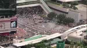 Hong Kong police fire tear gas into crowd of protesters [Video]