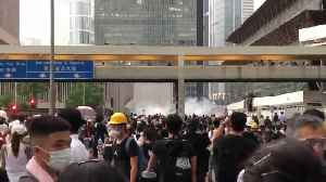 Police fire tear gas from above as protesters gather in Hong Kong [Video]