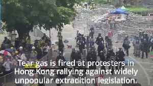 Hong Kong protests: Police fire tear gas as extradition rally escalates [Video]