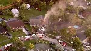 Firefighters battle house fire in suburban Lake Worth [Video]
