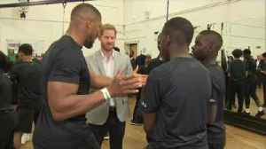 Prince Harry joined two of Britain's best known boxers to help launch a children's charity campaign. [Video]