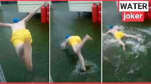 Holidaymaker jumping into floodwater [Video]