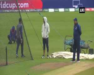 News video: Injured Shikhar Dhawan seen supporting Men In Blue at practise session