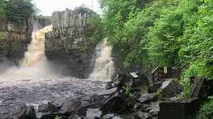 Water gushes over the High Force Waterfall on River Tees [Video]