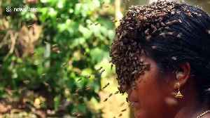 Indian woman covers her face with hundreds of bees to raise conservation awareness [Video]