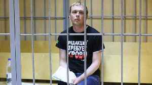Russian Journalist's Arrest Triggers Protests, Police Firings [Video]