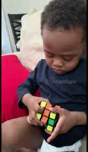 Genius three-year-old boy solves his first Rubik's Cube [Video]