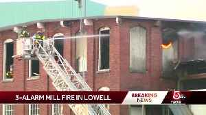Firefighters search for cause of 3-alarm mill fire in Lowell [Video]