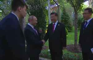 News video: Putin wishes Xi happy birthday, gives box of ice cream as present