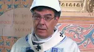 News video: Cover Your Head: Congregants Don Hard Hats To Worship In Notre-Dame Cathedral