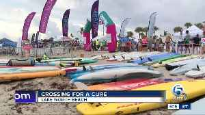 Crossing for a Cure event held in Lake Worth Beach. [Video]